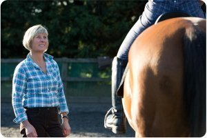 Rosie Withey from horses as teachers coaching a riding client during a workshop near Bristol UK