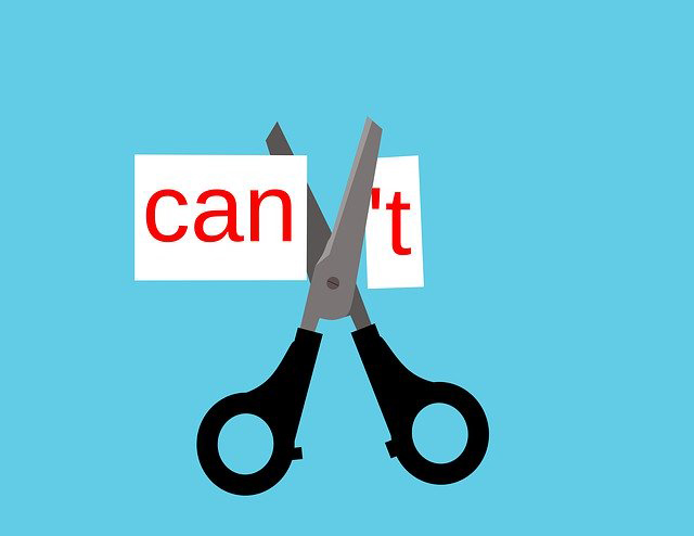Illustration of a pair of scissors cutting the T off the word 'Can't' to make the word 'can'