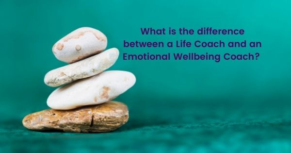Four smooth pebbles on top of each other other against a serene turquoise background. The text on the image says what is the difference between a life coach and an emotional wellbeing coach.